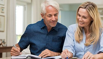 Man and woman looking at clipoboard with paperwork