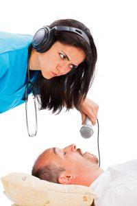 Doctor recording snoring