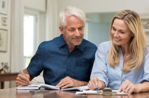 Man and woman discussing insurance paperwork