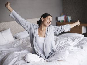 Woman waking up feeling refreshed