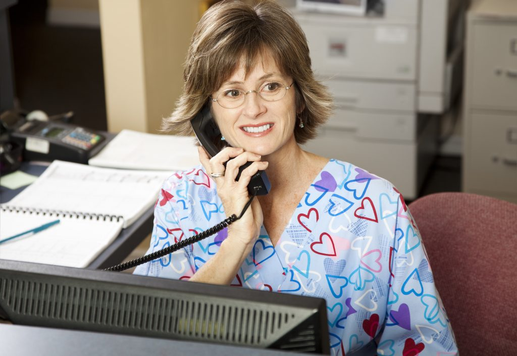 Dental team member answering the phone