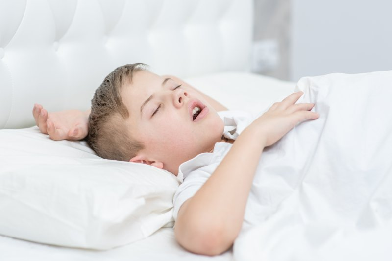 a young boy asleep