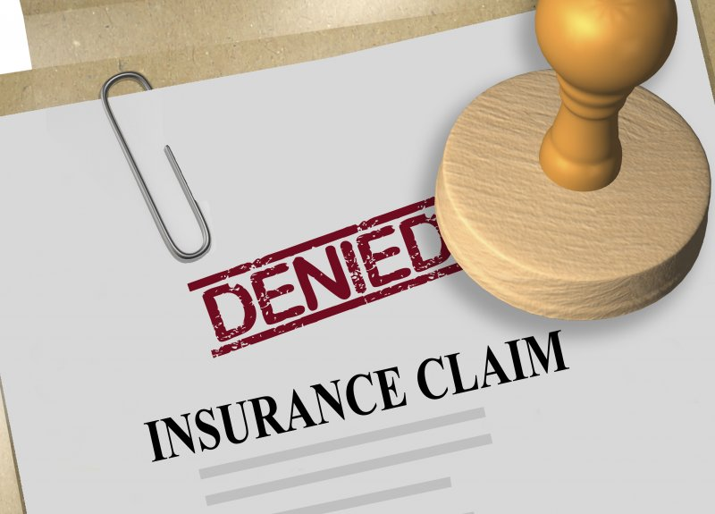 "Animated image of a ""Denied"" stamp sitting on an insurance claim"